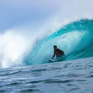 Surf Instructor Akaa Maulana getting barreled