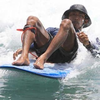 instructor-Edo-playing-on-surfboard-bali