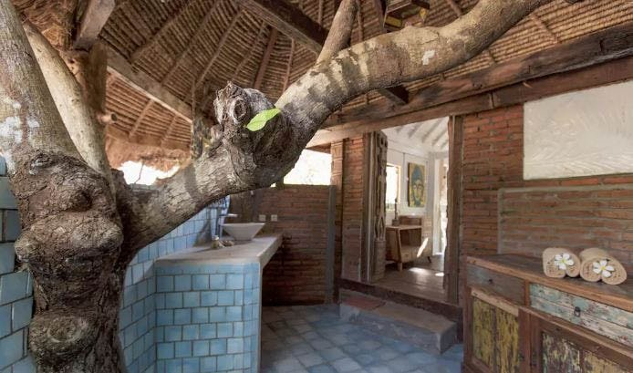 blanche neige bathroom with tree the alchemist bali balangan