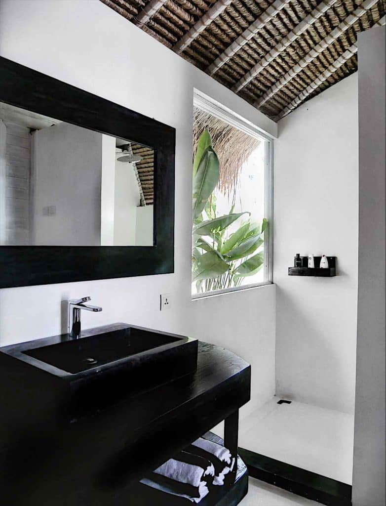 cocotastic bathroom at white palm bali hotel surf house balangan