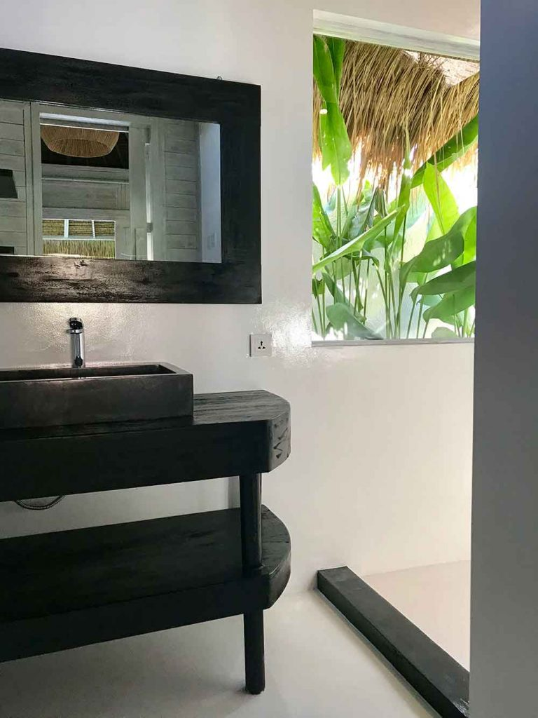 tropimoon lumbung bathroom at white palm bali surf house